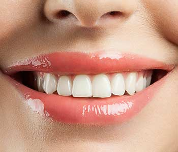 How are dental implants used with a traditional denture in, Yadkinville NC area